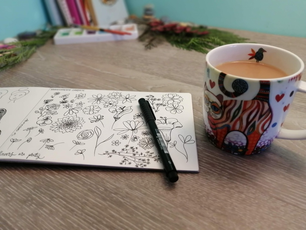 A page from my sketchbook with various flowers and a tea cup. It's ok to be a work in progress.